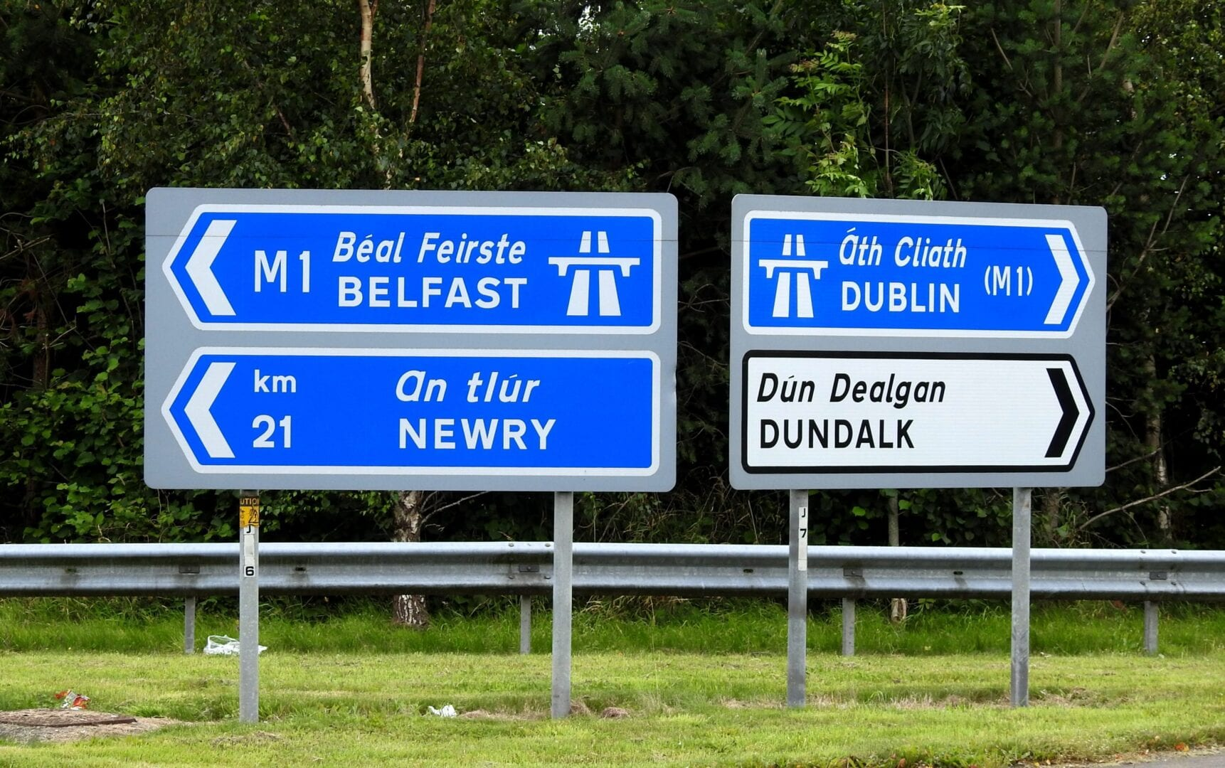 sign post for belfast, newry and dundalk, dublin for green card